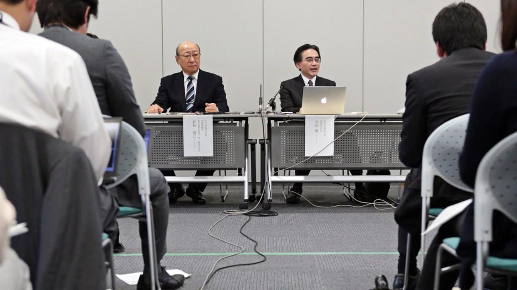 Satoru Iwata; Tatsumi Kimishima[/caption]  <div class=